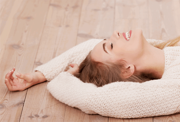 Woman laying on heated timber floor