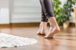 Woman walking in the house on the warm floor.