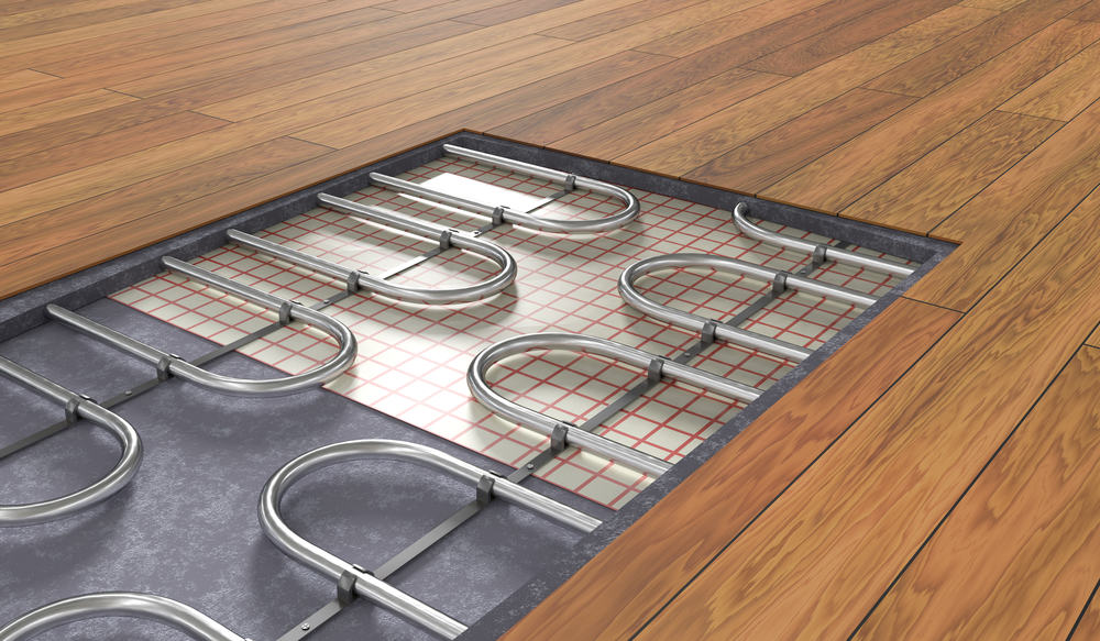 Underfloor heating system under wooden floor.
